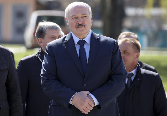 FILE - In this Monday April 26, 2021 file photo, Belarus President Alexander Lukashenko, accompanied by officials, attends a requiem rally on the occasion of the 35th anniversary of the Chernobyl disaster in the town of Bragin, some 360 km (225 miles) south-east of Minsk, Belarus. Raman Pratasevich, a founder of a messaging app channel that has been a key information conduit for opponents of Belarus' authoritarian president, has been arrested after an airliner in which he was riding was diverted to Belarus because of a bomb threat. The presidential press service said President Alexander Lukashenko personally ordered that a MiG-29 fighter jet accompany the Ryanair plane — traveling from Athens, Greece, to Vilnius, Lithuania — to the Minsk airport. (Sergei Sheleg/BelTA Pool Photo via AP, File)