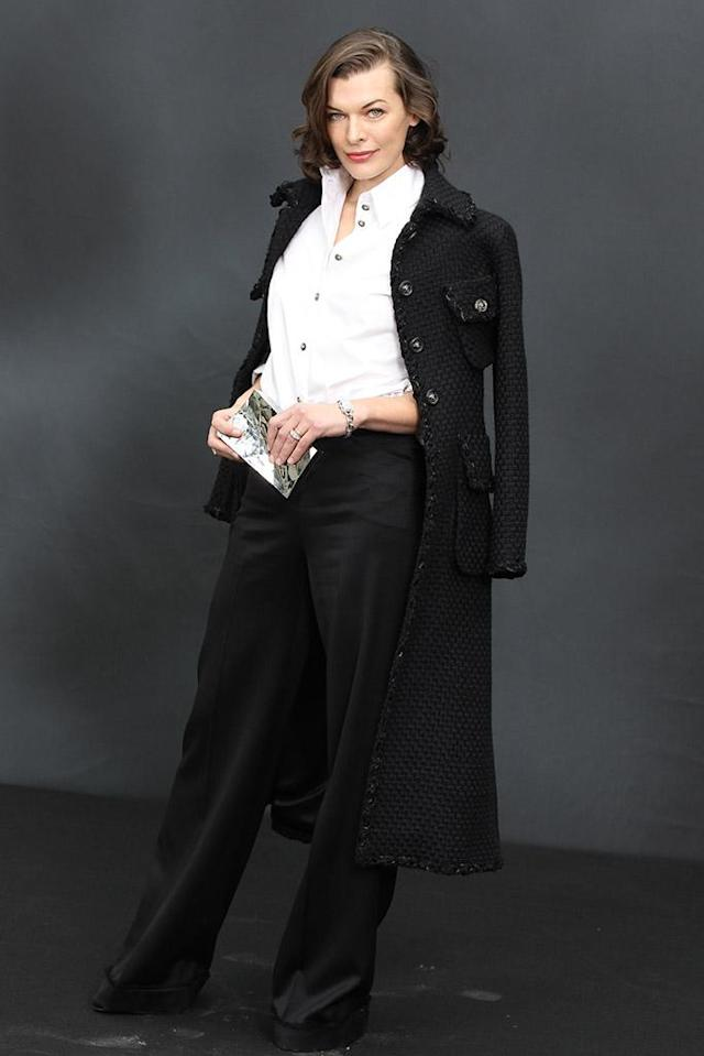 "Also sporting a sophisticated outfit in the City of Light was ""Resident Evil"" star Milla Jovovich, who attended the Chanel fashion show in this masculine, black-and-white look, along with a military-inspired jacket. Effortlessly luxe, as expected. (3/5/2013)"