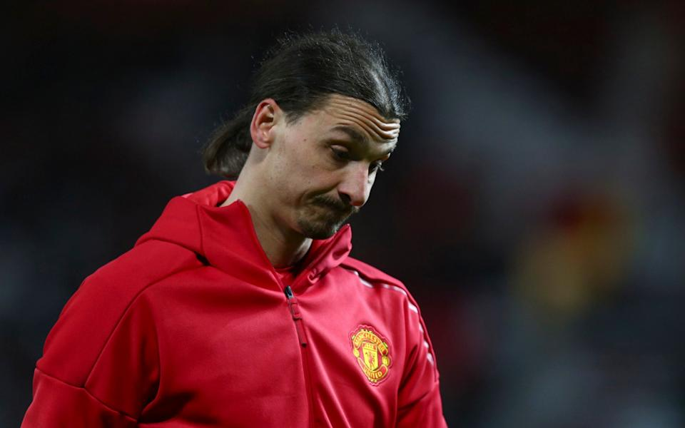 Man Utd's Zlatan Ibrahimovic walks on the pitch before the Europa League round of 16 - Credit: AP