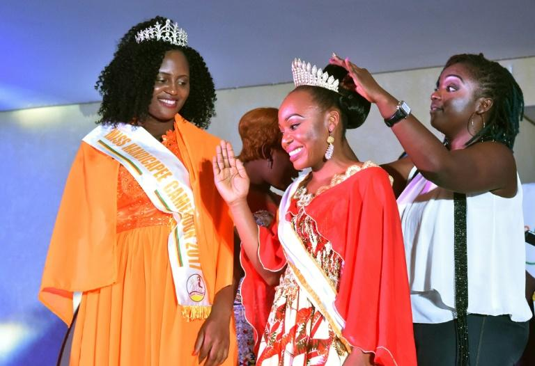 Getheme Lokou, who lost an arm in a childhood accident, was crowned Miss Handicap Ivory Coast 2018 as her Cameroonian counterpart Laura Tchokotcheu -- also an amputee -- looked on