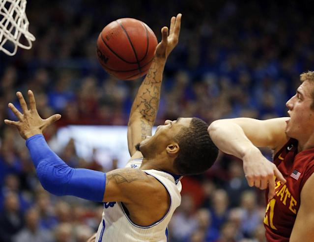 Iowa State guard Matt Thomas, right, blocks a shot by Kansas guard Frank Mason, left, during the first half of an NCAA college basketball game in Lawrence, Kan., Wednesday, Jan. 29, 2014. (AP Photo/Orlin Wagner)
