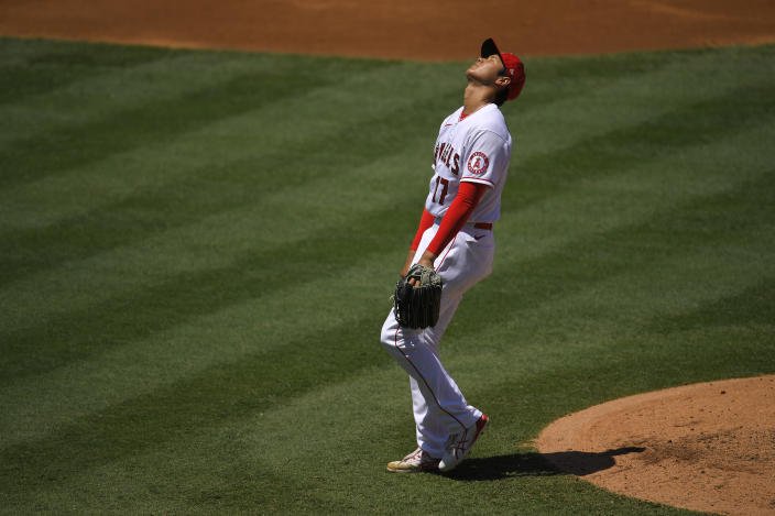 Los Angeles Angels designated hitter Shohei Ohtani, of Japan, reacts as he walks in a run during the second inning of a baseball game against the Houston Astros Sunday, Aug. 2, 2020, in Anaheim, Calif. (AP Photo/Mark J. Terrill)