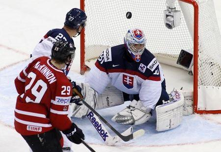 Slovakia's goaltender Laco fails to save a goal of Canada's MacKinnon during the third period of their men's ice hockey World Championship group A game at Chizhovka Arena in Minsk