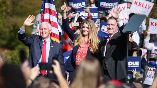 PHOTO: Vice President Mike Pence waves to supporters at a rally in Canton, Ga., along with Sen. David Perdue and Sen. Kelly Loeffler, Nov. 20, 2020. (Los Angeles Times via Getty Images)
