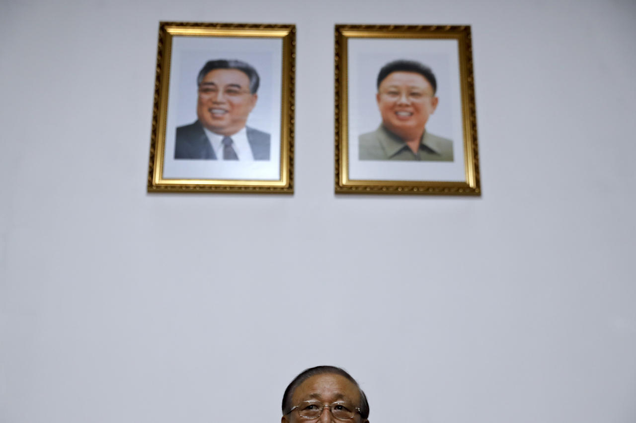 Under the portraits of the late North Korean leaders, Kim Il Sung, left, and Kim Jong Il, North Korean Ambassador to China Ji Jae Ryong looks during a press conference at the North Korean Embassy in Beijing, Monday, May 15, 2017. Ji says that Pyongyang's test-firing of a ballistic missile over the weekend is part of the country's efforts to develop ways to defend itself against hostile aggression abroad. (AP Photo/Andy Wong)