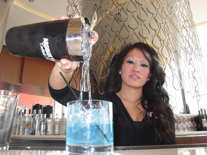 Mary Ma, a bartender at Revel in Atlantic City, N.J., pours a drink at one of the casino's bars Monday, April 8, 2013. Atlantic City officials unveiled a $20 million campaign on Tuesday, April 9, to attract more tourists to the seaside gambling resort. The campaign highlights the resort's food, drink, entertainment, gambling and relaxation offerings. (AP Photo/Wayne Parry)