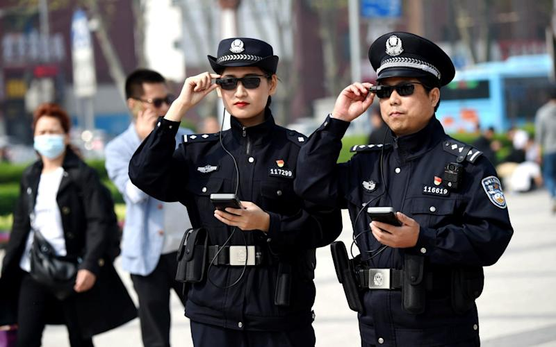 Police officers display their AI-powered smart glasses - REUTERS