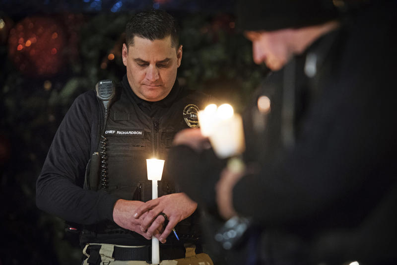 FILE - In this Friday, Dec. 28, 2018 file photo, Newman Police Chief Randy Richardson and hundreds of others attend a vigil in memory of police Cpl. Ronil Singh in Newman, Calif. The Northern California police officer was gunned down during a traffic stop the day after Christmas 2018. (Andy Alfaro/The Modesto Bee via AP,File)