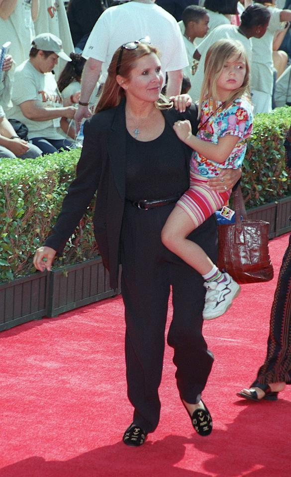 Billie gets a lift from her mom at the 1999 premiere of <em>Tarzan</em>.
