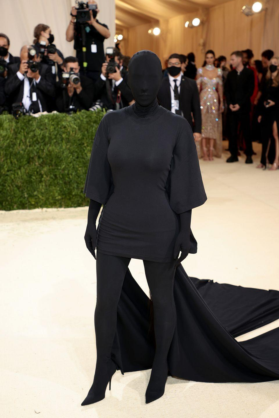 <p>Well, she certainly won't have to worry about hand sanitizer or mask-wearing all night. We'll call this the ultimate in Covid Couture. It's weird, but we respect it. </p>
