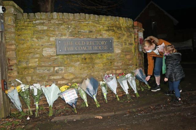 Floral tributes left outside the home of Sir Tom (Yui Mok/PA)