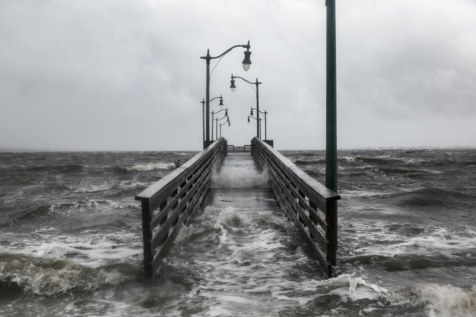 Strong gusts of wind and bands of heavy rain cover a walkway at the Jensen Beach Causeway Park in Jensen Beach, Florida (Picture: AFP/Getty Images)