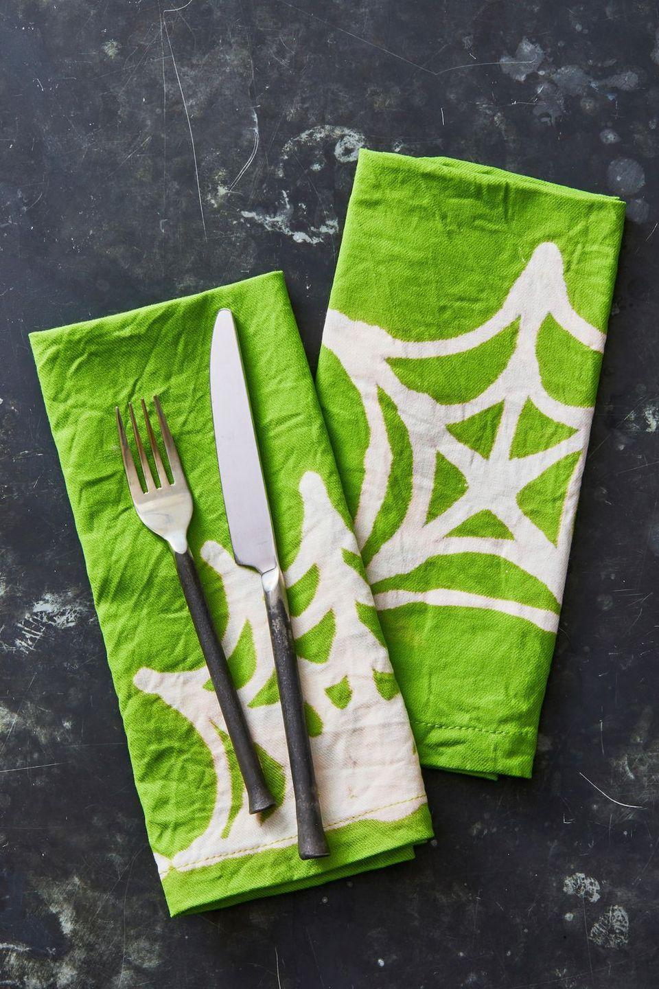 """<p>Wow your dinner guests with these hand-drawn napkins. Use a bleach pen to draw a spiderweb design on the front of cloth napkins. Let them sit for at least two hours and watch as the design turns completely white. Just rinse and dry the napkins before sticking them on the table. </p><p><a class=""""link rapid-noclick-resp"""" href=""""https://www.amazon.com/Laodicea-Home-Napkins-Comfortable-Reusable/dp/B07Z9GRR5N/?tag=syn-yahoo-20&ascsubtag=%5Bartid%7C10055.g.421%5Bsrc%7Cyahoo-us"""" rel=""""nofollow noopener"""" target=""""_blank"""" data-ylk=""""slk:SHOP CLOTH NAPKINS"""">SHOP CLOTH NAPKINS</a></p>"""