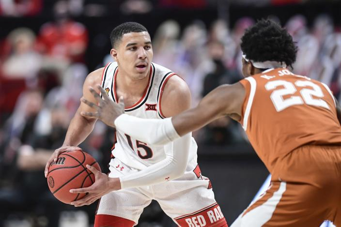 Texas Tech's Kevin McCullar (15) controls the ball during the first half of an NCAA college basketball game against Texas in Lubbock, Texas, Saturday, Feb. 27, 2021. (AP Photo/Justin Rex)