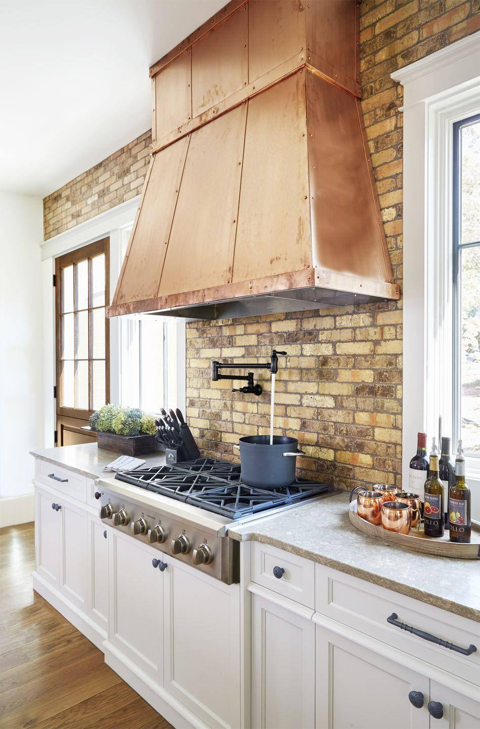 "<p>The open shelving trend isn't going anywhere, and in a kitchen void of upper cabinetry, the hood is inevitably the centerpiece. Dress it accordingly! Copper sheeting, with coordinating straps and rivets, adds age-old warmth<span class=""redactor-invisible-space"">.</span></p><p><span class=""redactor-invisible-space""><a class=""link rapid-noclick-resp"" href=""https://fave.co/2M77YsD"" rel=""nofollow noopener"" target=""_blank"" data-ylk=""slk:SHOP COPPER HOODS"">SHOP COPPER HOODS</a><br></span></p>"