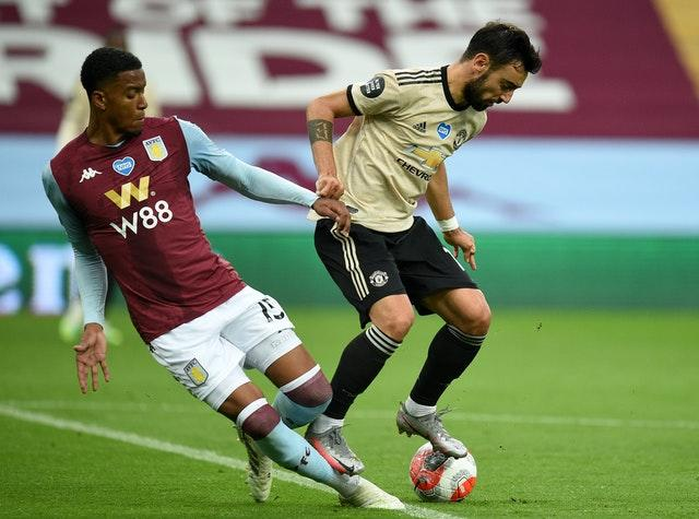 Aston Villa defender Ezri Konsa, left, was ruled to have fouled Manchester United's Bruno Fernandes
