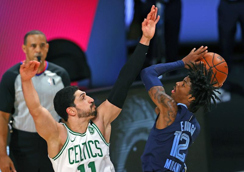 Boston Celtics' Enes Kanter defends against Memphis Grizzlies' Ja Morant on Tuesday in Lake Buena Vista, Fla.
