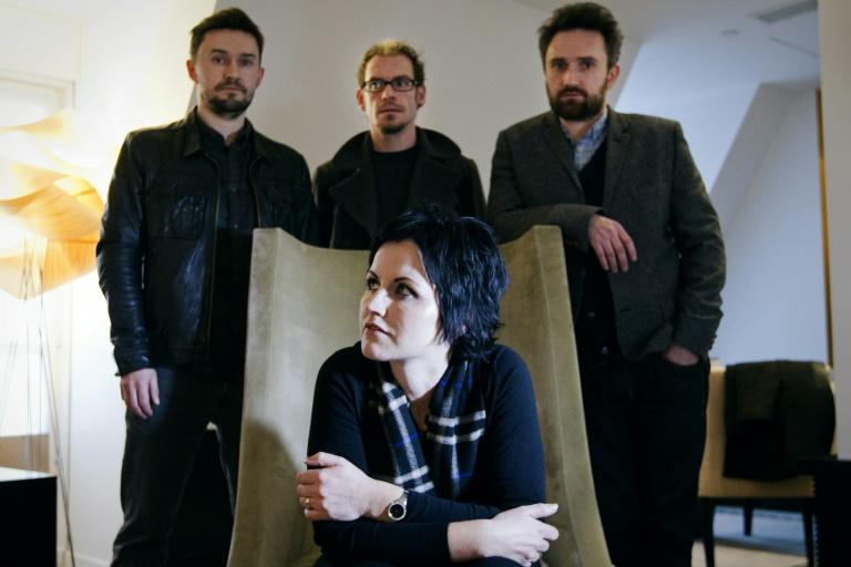 The Cranberries in Paris in 2012. Behind O'Riordan from left to right are bassist Mike Hogan, drummer Fergal Lawler and guitarist Noel Hogan