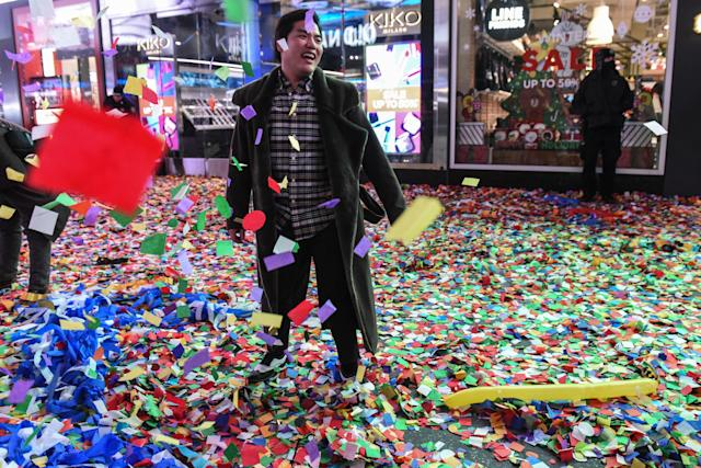 <p>People throw confetti on New Year's Eve in Times Square on January 1, 2018 in New York City. (Photo: Stephanie Keith/Getty Images) </p>