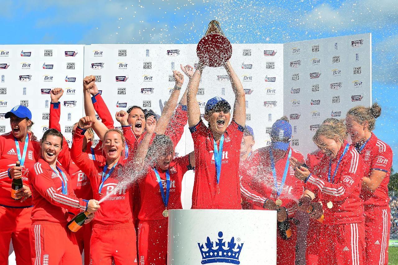 England women's team celebrate with the Ashes trophy during the second Women's International T20 at the Emirates Durham ICG, Durham.