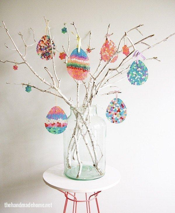 """<p>Another kid-friendly project, this tree utilizes plastic beads and a hot oven to make the stained glass-like ornaments that hang from its branches. </p><p><strong>Get the tutorial at <a href=""""https://www.thehandmadehome.net/2014/02/how-to-make-an-easter-egg-tree-diy-sun-catchers/"""" rel=""""nofollow noopener"""" target=""""_blank"""" data-ylk=""""slk:The Handmade Home"""" class=""""link rapid-noclick-resp"""">The Handmade Home</a>.</strong></p><p><a class=""""link rapid-noclick-resp"""" href=""""https://www.amazon.com/Amaney-Pieces-Glitter-Transparent-Plastic/dp/B07LBRVJLV/ref=sr_1_2?tag=syn-yahoo-20&ascsubtag=%5Bartid%7C10050.g.26498744%5Bsrc%7Cyahoo-us"""" rel=""""nofollow noopener"""" target=""""_blank"""" data-ylk=""""slk:SHOP PLASTIC BEADS"""">SHOP PLASTIC BEADS</a></p>"""