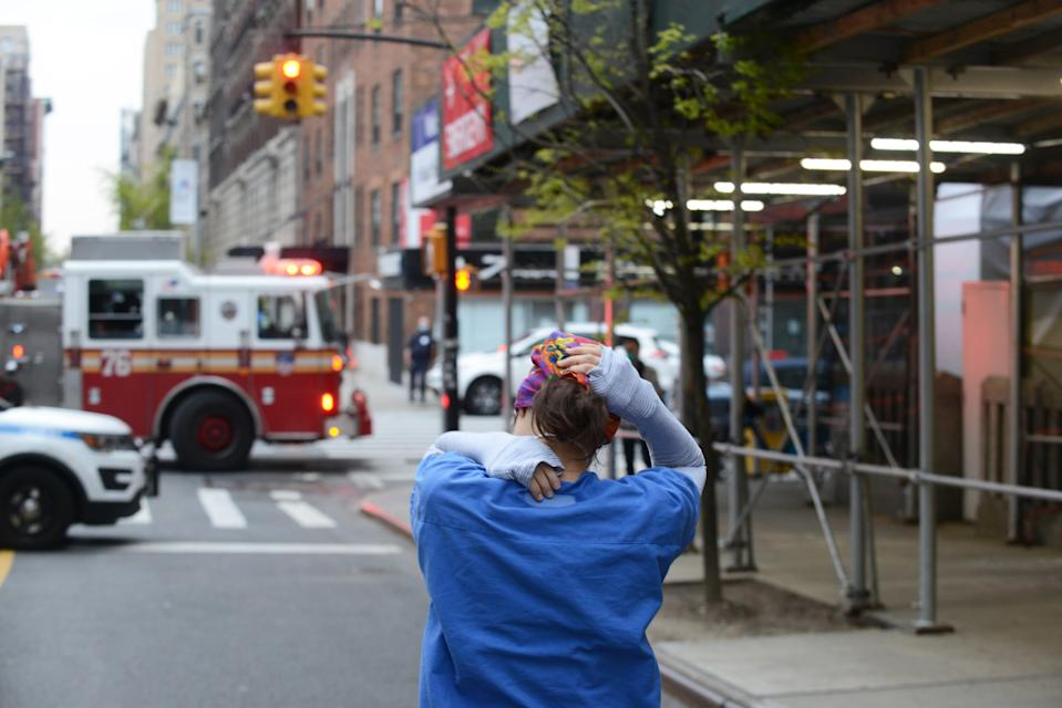 A nurse in the streets of New York City.
