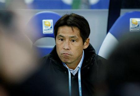 FILE PHOTO: Akira Nishino, head coach of Japan's Gamba Osaka, watches their FIFA Club World Cup third-place playoff soccer match against Mexico's Pachuca in Yokohama, south of Tokyo, Japan December 21, 2008. REUTERS/Toru Hanai/File Photo