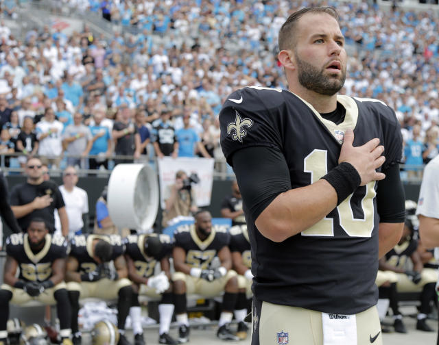 <p>New Orleans Saints quarterback Chase Daniel (10) stands with his hand over his heart during the national anthem as other Saints players sit on the bench before an NFL football game against the Carolina Panthers in Charlotte, N.C., Sept. 24, 2017. (Photo: Bob Leverone/AP) </p>