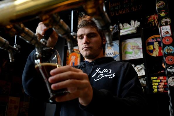 Yulli'e Brews director James Harvey pours a glass of beer for a customer at his brewery in Sydney.
