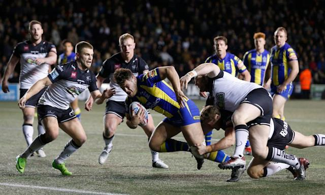 "<span class=""element-image__caption"">Joe Philbin scores the third try for Warrington against Widnes in the Super League match at the Select Security Stadium.</span> <span class=""element-image__credit"">Photograph: Ed Sykes/Reuters</span>"