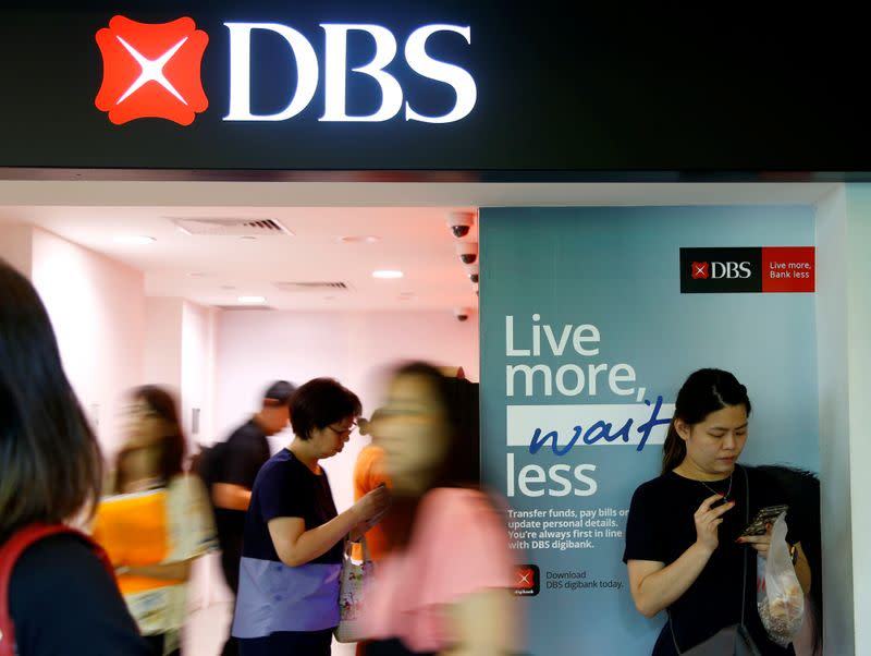 People walk past a DBS branch in Singapore