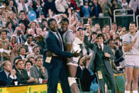 FILE - In this April 2, 1984, file photo, Georgetown head coach John Thompson, left, gives a happy pat to the most valuable player Patrick Ewing, after Georgetown defeated Houston 84-75 in Seattle. John Thompson, the imposing Hall of Famer who turned Georgetown into a Hoya Paranoia powerhouse and became the first Black coach to lead a team to the NCAA mens basketball championship, has died. He was 78 His death was announced in a family statement Monday., Aug. 31, 2020. No details were disclosed.(AP Photo/File)
