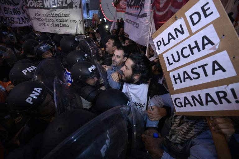 Teachers clash with Argentine security forces during a 24-hour general strike demanding President Mauricio Macri take action against inflation and keep campaign promises
