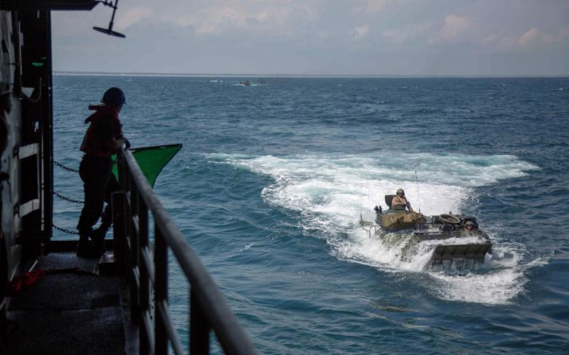 US Marine Corps have released this photo of AAV-P7/A1 Assault Amphibian Vehicles with the 22nd Marine Expeditionary Unit during training in the Atlantic Ocean in 2018 - SGT. ANDREW OCHOA/US MARINE CORPS/AFP