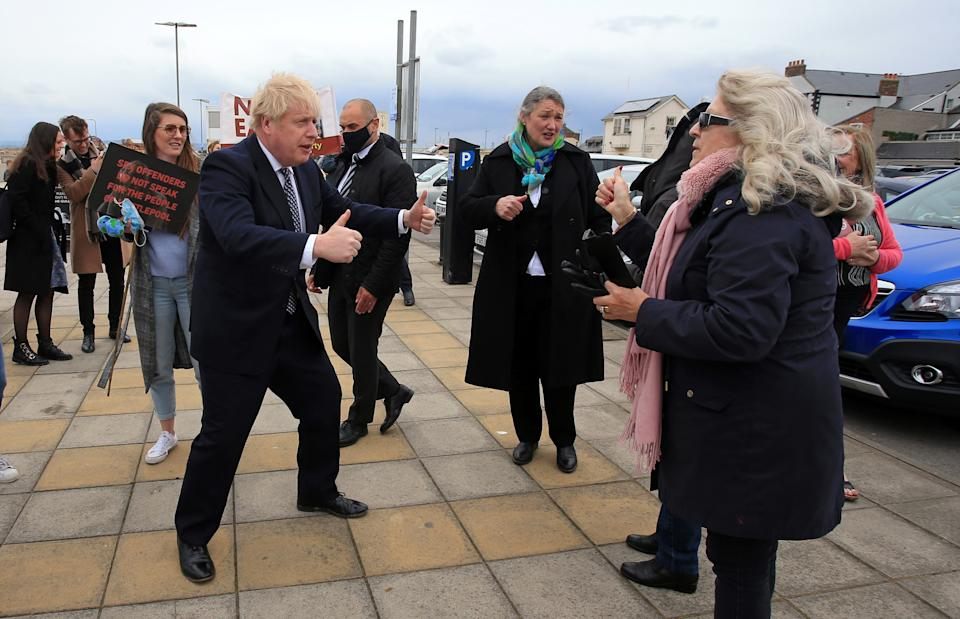 Prime Minister Boris Johnson (fourth left) gestures as he campaigns on behalf of Conservative Party candidate Jill Mortimer (centre) in Hartlepool, in the north-east of England ahead of the 2021 Hartlepool by-election to be held on May 6. Picture date: Monday May 3, 2021.