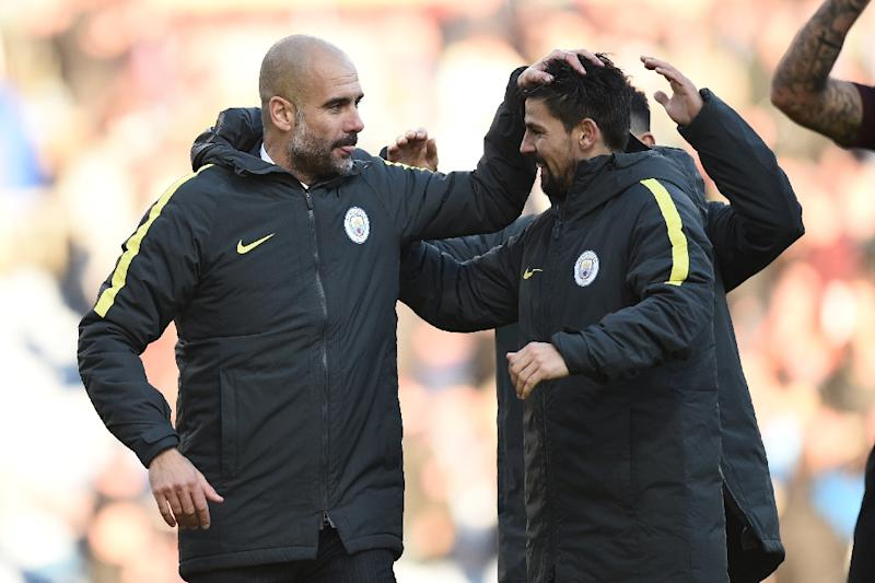 Manchester City manager Pep Guardiola (L) will have a whole week to get ready for the Etihad Stadium clash with Chelsea, which brings together two likely title contenders (AFP Photo/Oli Scarff                  )
