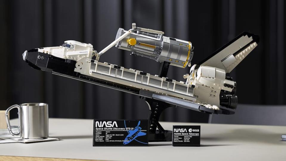 LEGO's Discovery Space Shuttle set on a desk and opened to show its Hubble Telescope