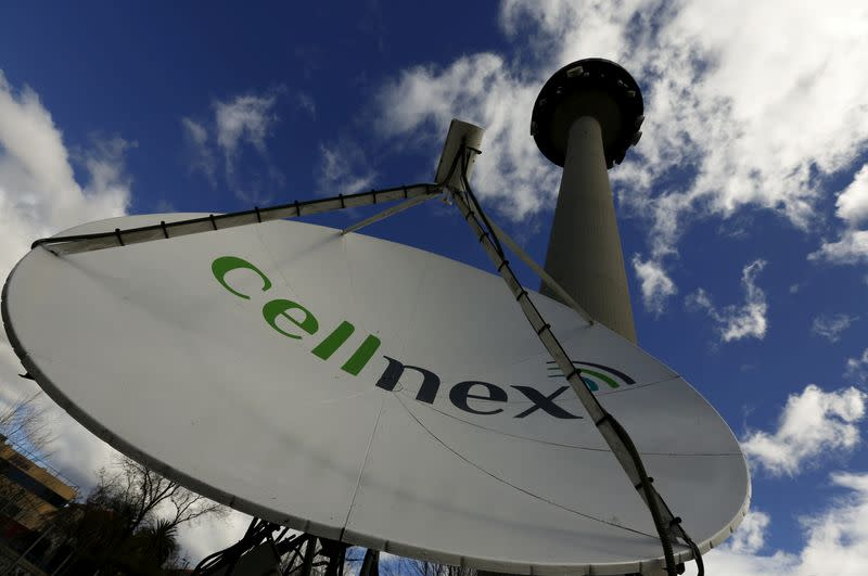 "FILE PHOTO: A telecom antenna of Spain's telecoms infrastructures firm Cellnex are seen under main telecom tower, known as ""Piruli"", in Madrid"