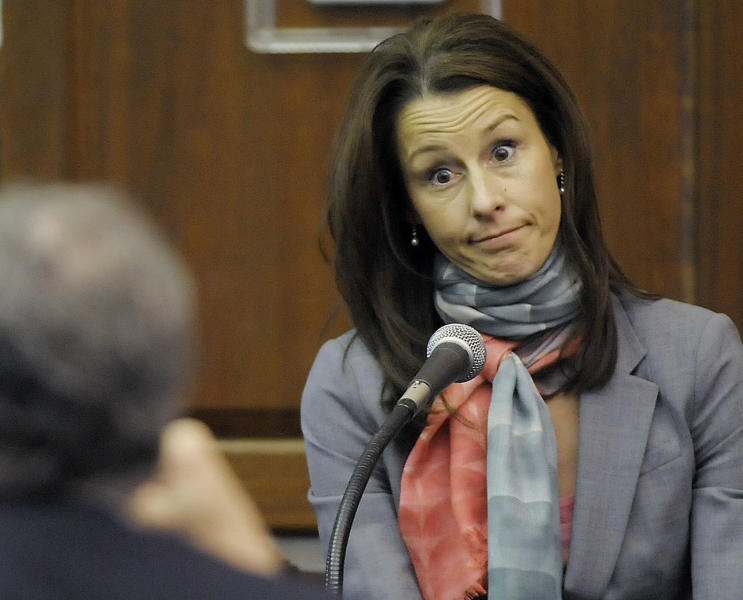 FILE -In this Tuesday, March 9, 2010 file photo, Cheri Young, wife of Andrew Young the former aide to former Senator John Edwards, testifies on the existence and location of a disc and missing flash drive during a hearing at the Chatham County Superior Court House in Pittsboro, N.C. Cheri Young, wife of Andrew Young the former aide to former Senator John Edwards said Monday, April 30, 2012, she insisted the former presidential candidate tell her it was legal to take money from a wealthy donor to hide Edwards' mistress. (AP Photo/Sara D. Davis, File)