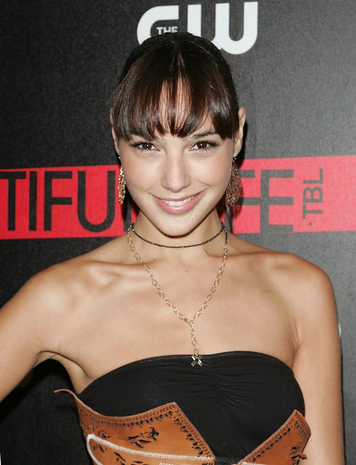 <p>Wearing her hair in a high pony with a full set of bangs and a natural face, Gadot attends the CW Network celebration of the series <em>The Beautiful Life: TBL</em>. (2009)</p>