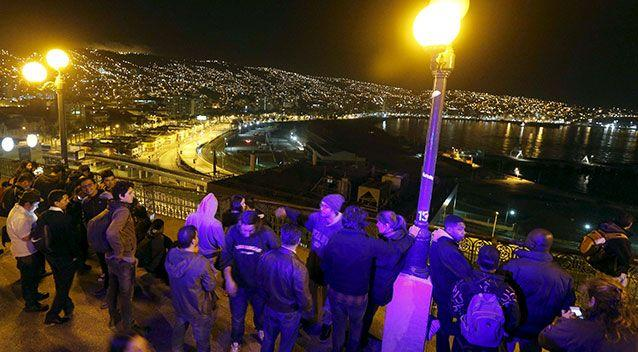 Santiago residents watch the sea in Chile after a powerful quake. Photo: Reuters