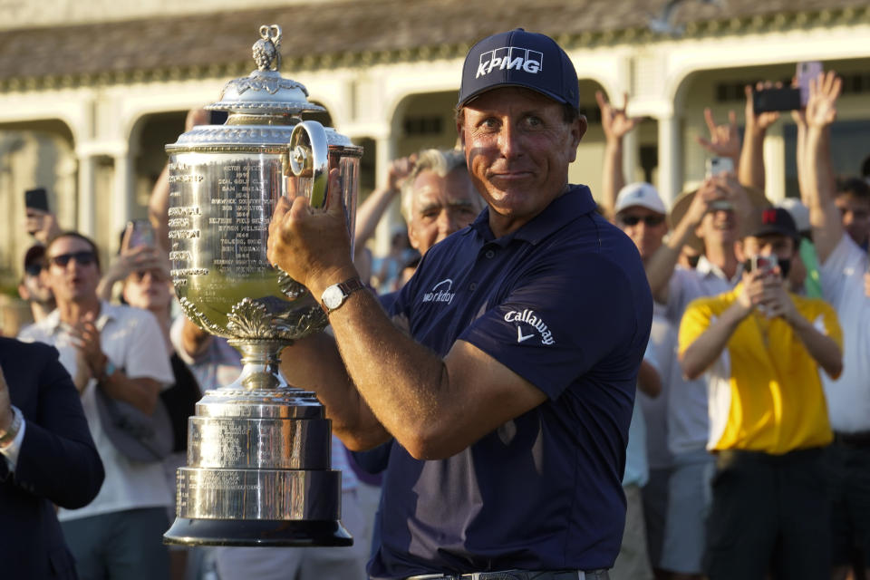 Phil Mickelson holds the Wanamaker Trophy after winning the final round at the PGA Championship golf tournament on the Ocean Course, Sunday, May 23, 2021, in Kiawah Island, S.C. (AP Photo/Matt York)
