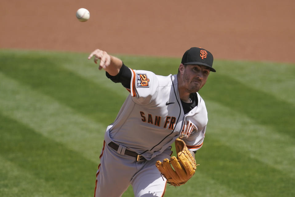 San Francisco Giants' Kevin Gausman pitches against the Oakland Athletics during the first inning of a baseball game in Oakland, Calif., Saturday, Sept. 19, 2020. (AP Photo/Jeff Chiu)