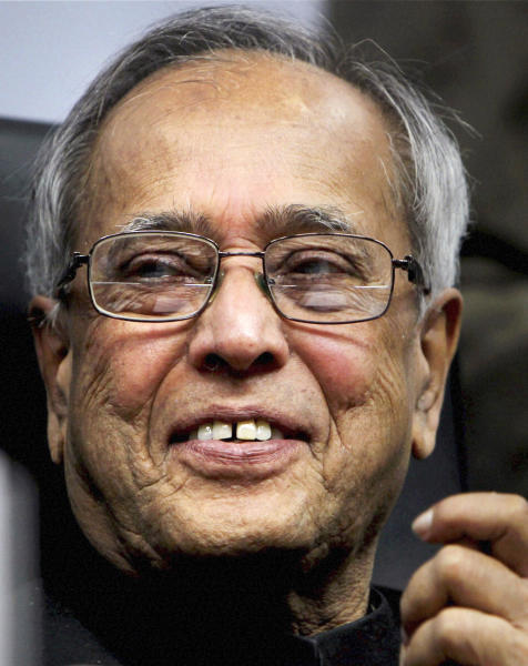 FILE - In this March 24, 2012 file photo, Indian Finance Minister Pranab Mukherjee, smiles during a function in New Delhi, India. Mukherjee, who spent years whipping coalition partners into shape and quelling scandals as the Congress Party's chief firefighter, seems likely to leave all that behind and become India's figurehead president in an election Thursday, July 18, 2012. (AP Photo/File)
