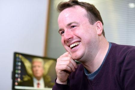 "FILE PHOTO: Matt Forde talks about his TV show ""Unspun"" in an interview at Reuters' office in Canary Wharf, London"