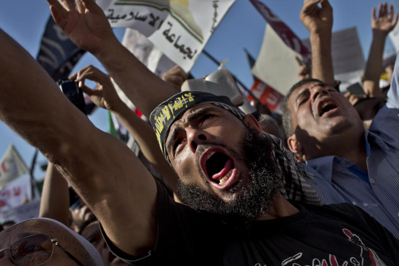 Egyptian Muslims shout Islamic slogans during a rally in Tahrir Square in Cairo, Egypt, Friday, Nov. 9, 2012. Thousands of ultraconservative Muslims rallied in the Egyptian capital, demanding the country's new constitution be based on the rulings of Islamic law, or Shariah. (AP Photo/Bernat Armangue)