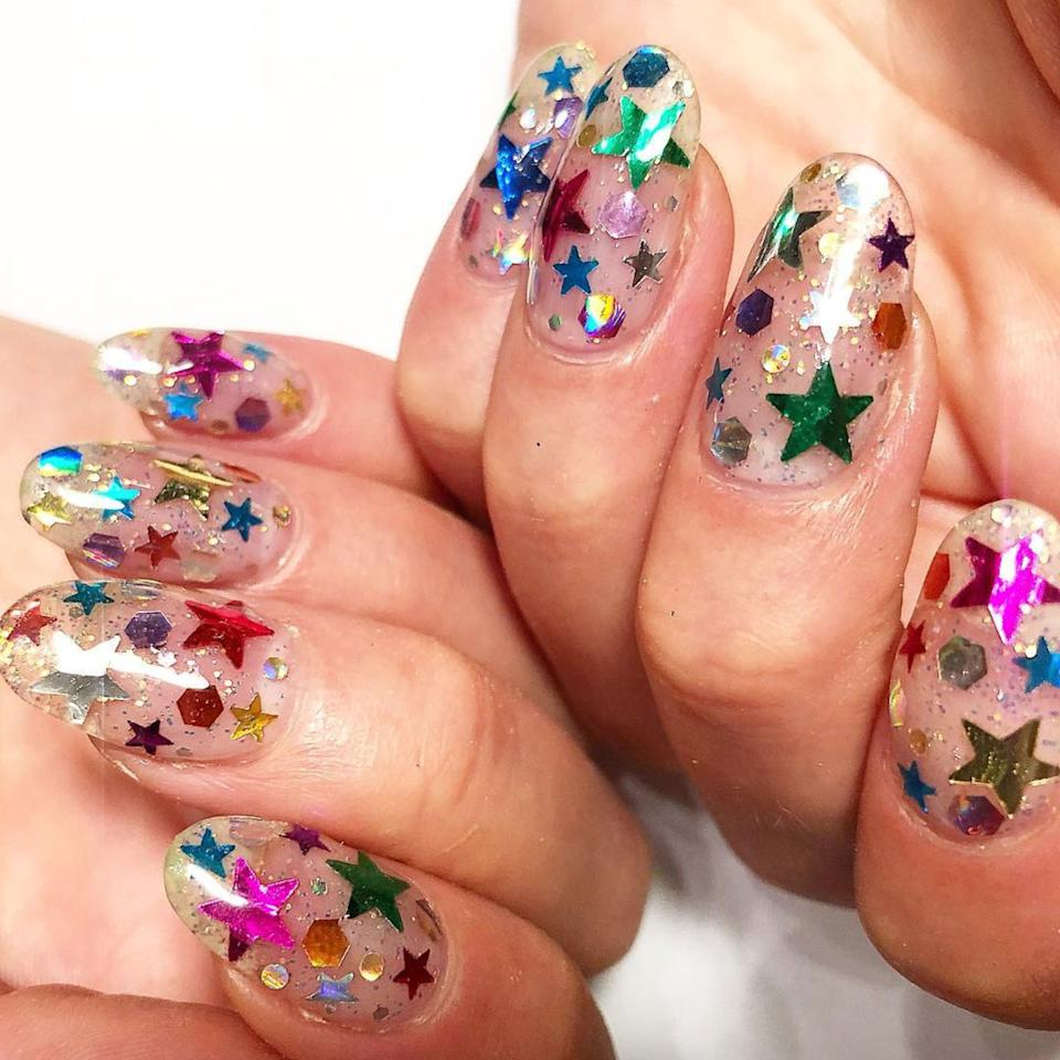 """<p>Nothing says """"It's summer, let's celebrate"""" quite like confetti nails. Just imagine your digits decked out in glitter, foiled stars, and sequins as you sip on a glass of rosé, or as you dance out of work on a summer Friday. Sounds nice, right? Confetti nails are especially cool in that they take a few different popular nail appliqués, like stars and sparkles, and meld them together to make one amazing, party-ready manicure. And of course, it's completely customizable.</p> <p>Editors and influencers alike have both been seen <a href=""""https://www.allure.com/story/confetti-nail-art-trend?mbid=synd_yahoo_rss"""">wearing the trend</a>, too, so if you've got a soft spot in your heart for sparkle, we highly suggest giving confetti nails a try. Here's <a href=""""https://www.allure.com/story/confetti-nail-art-trend?mbid=synd_yahoo_rss"""">more inspiration</a>.</p>"""