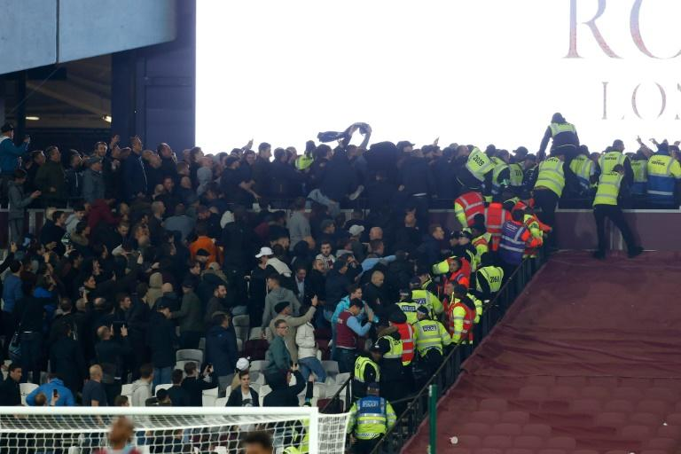 Police and stewards try to separate West Ham and Chelsea supporters during the EFL Cup fourth round match at The London Stadium in east London on October 26, 2016
