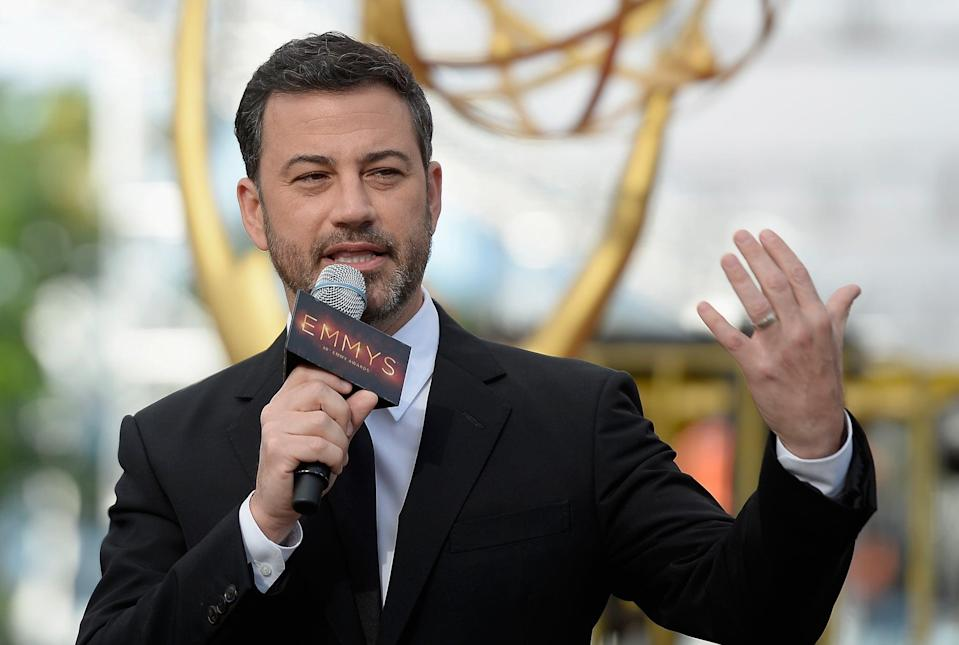 LOS ANGELES, CA - SEPTEMBER 14:  (EDITORS NOTE: Alternative crop of image 605663874) Host Jimmy Kimmel speaks during the red carpet  rollout for the 68th Emmy Awards press preview day at Microsoft Theater on September 14, 2016 in Los Angeles, California.  (Photo by Kevork Djansezian/Getty Images)