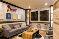 <p>Comfy seating + a bar setup + screens for every game = the perfect basement sports den.</p>
